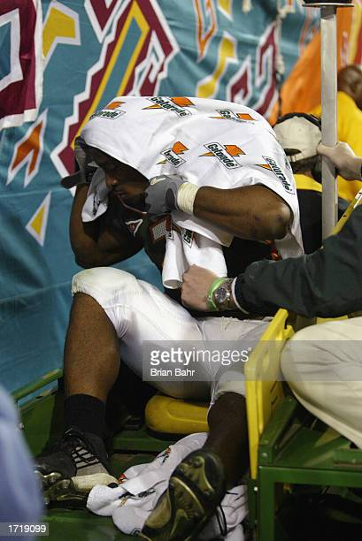 Running back Willis McGahee of the University of Miami Hurricanes is carted off the field after tearing ligaments in his knee during the BCS...