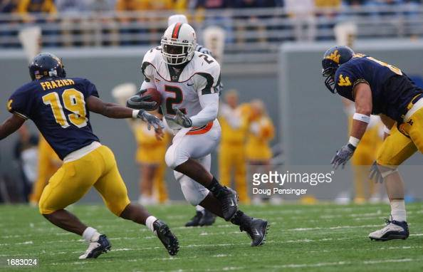 Running back Willis McGahee of the University of Miami Hurricanes runs the ball while being defended by defensive back Lance Frazier of the West...