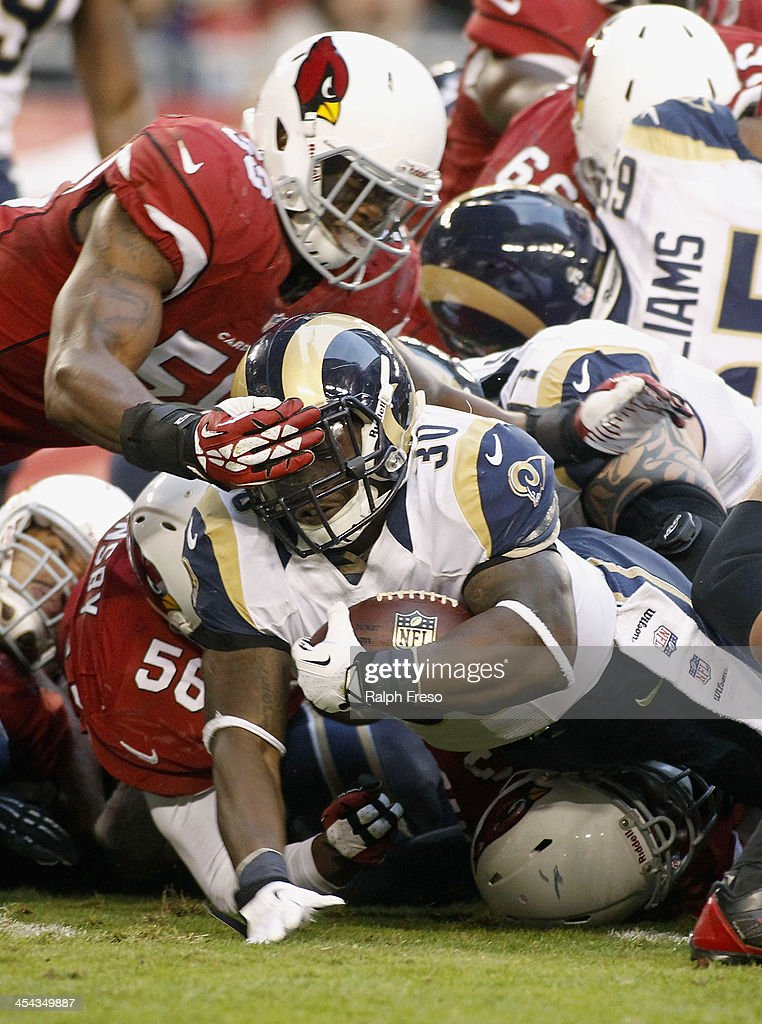 Running back <a gi-track='captionPersonalityLinkClicked' href=/galleries/search?phrase=Zac+Stacy&family=editorial&specificpeople=6513955 ng-click='$event.stopPropagation()'>Zac Stacy</a> #30 of the St Louis Rams dives for the endzone as Daryl Washinton #58 of the Arizona Cardinals defends during the third quarter of their NFL football game at University of Phoenix Stadium on December 8, 2013 in Glendale, Arizona.