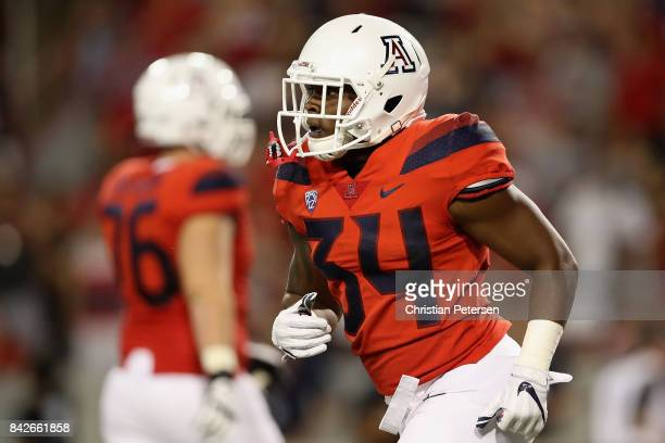 Running back Zach Green of the Arizona Wildcats is congratulated after scoring on a 37 yard rushing touchdown against the Northern Arizona...