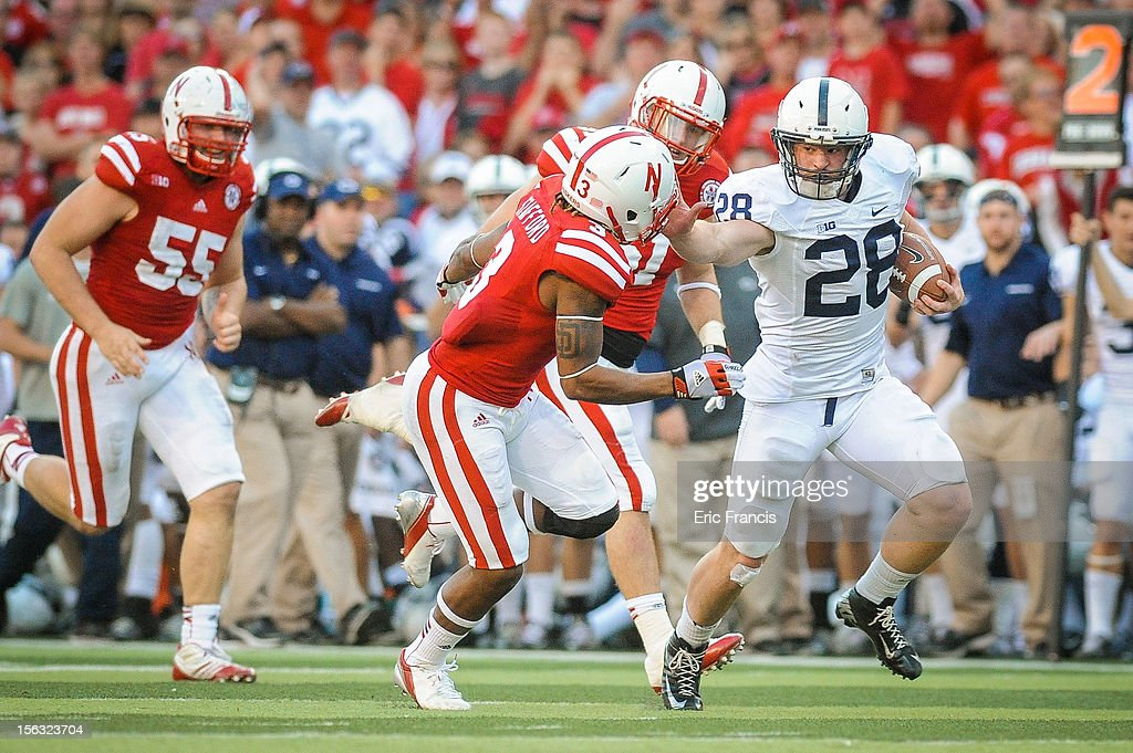 Running back Zach Zwinak #28 of the Penn State Nittany Lions stiff arms safety Daimion Stafford #3 of the Nebraska Cornhuskers during their game at Memorial Stadium on November 10, 2012 in Lincoln, Nebraska.