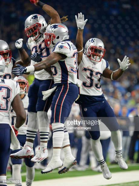 Running backs Brandon Bolden Mike Gilislee and Dion Lewis of the New England Patriots celebrate after a touchdown by Gilislee in the first quarter of...