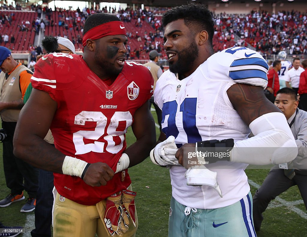 Running backs Ezekiel Elliott #21 of the Dallas Cowboys and Carlos Hyde #28 of the San Francisco 49ers talk at mid-field after the Cowboys' victory at Levi's Stadium on October 2, 2016 in Santa Clara, California.