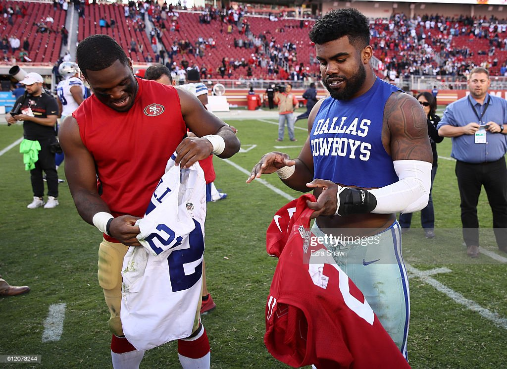 Running backs Ezekiel Elliott #21 of the Dallas Cowboys and Carlos Hyde #28 of the San Francisco 49ers trade jerseys after the Cowboys' victory at Levi's Stadium on October 2, 2016 in Santa Clara, California.