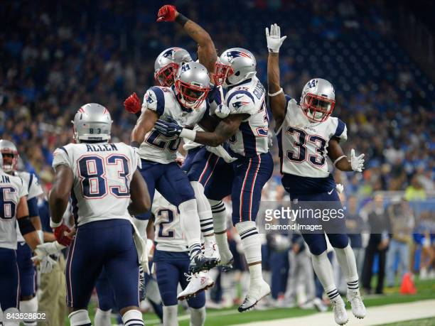 Running backs James White Brandon Bolden Mike Gilislee and Dion Lewis of the New England Patriots celebrate after a touchdown by Gilislee in the...