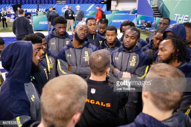 Running backs Leonard Fournette of LSU and Dalvin Cook of Florida State listen with a group of players during the NFL Combine at Lucas Oil Stadium on...