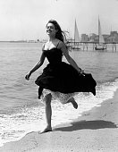 Running barefoot on the sands at Cannes French film star Brigitte Bardot