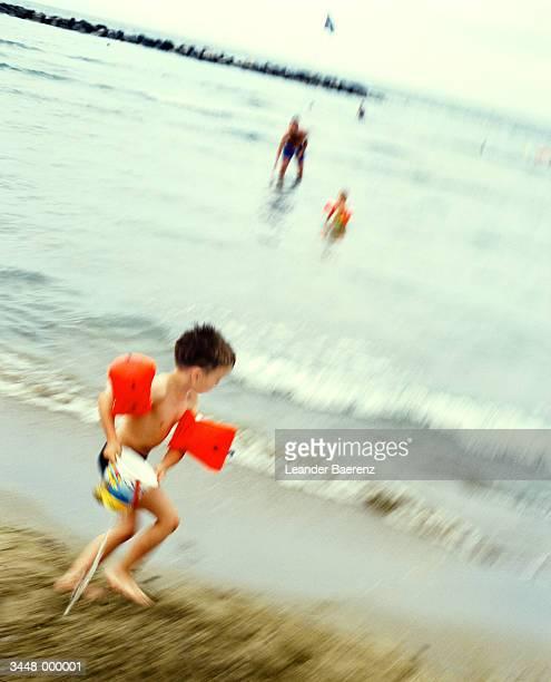 Running Boy into Sea
