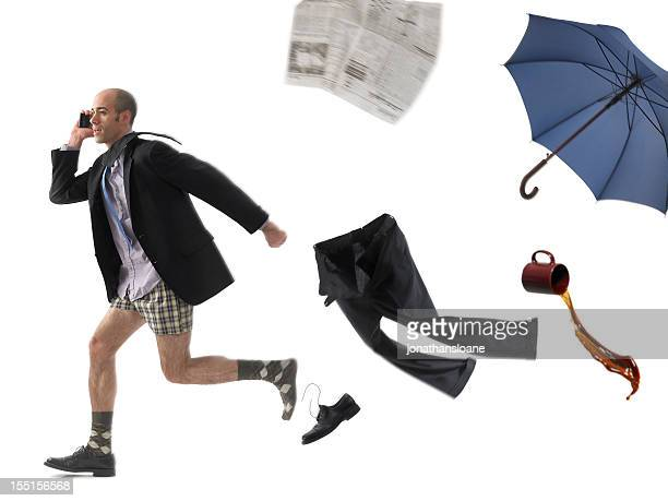 Running businessman on white background