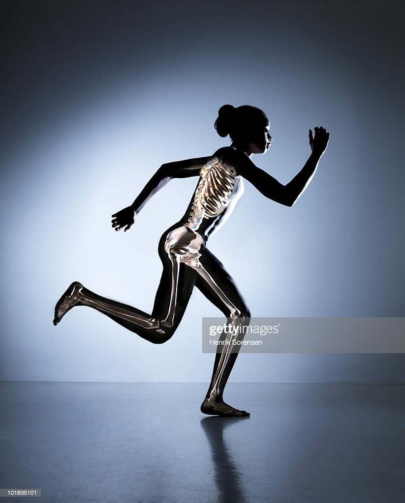 Running female with skeleton visible : Stock Photo