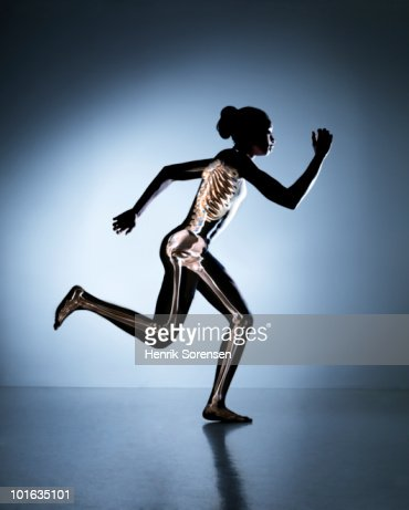Running female with skeleton visible : ストックフォト