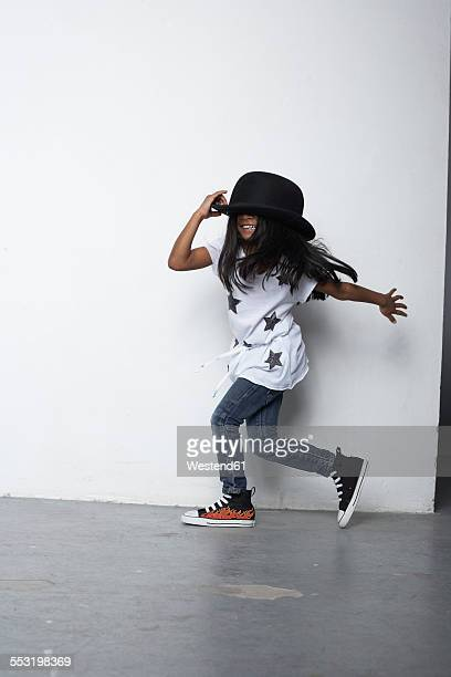 Running girl wearing bowler hat