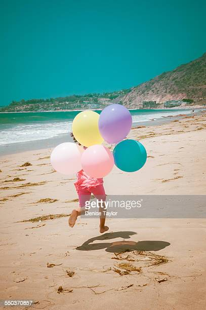Running girl with balloons