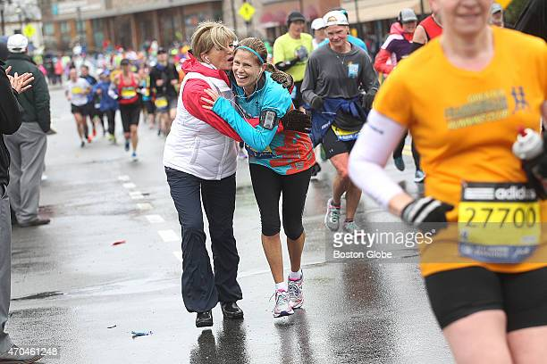 Running her 16th marathon Kelli Hesseltine of Westford and running for Dana Farber is greeted by her sister Patti Rocco of Gilford NH Runners leave...
