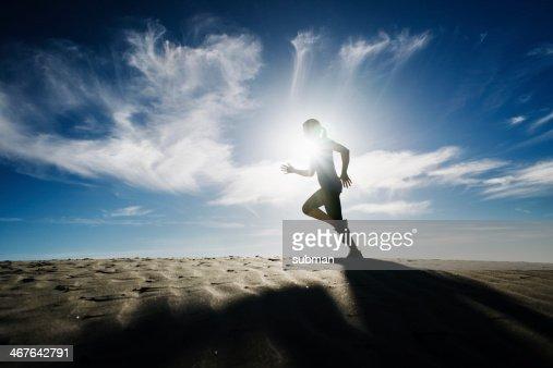 Running In The Dunes : Stock Photo