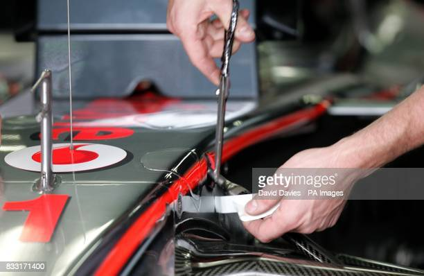 Running repairs to the McLaren Mercedes car of Fernando Alonso during the practice session at the Nurburgring