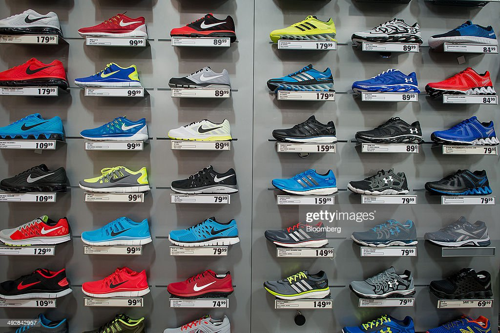 running shoes are displayed for sale at a s sporting