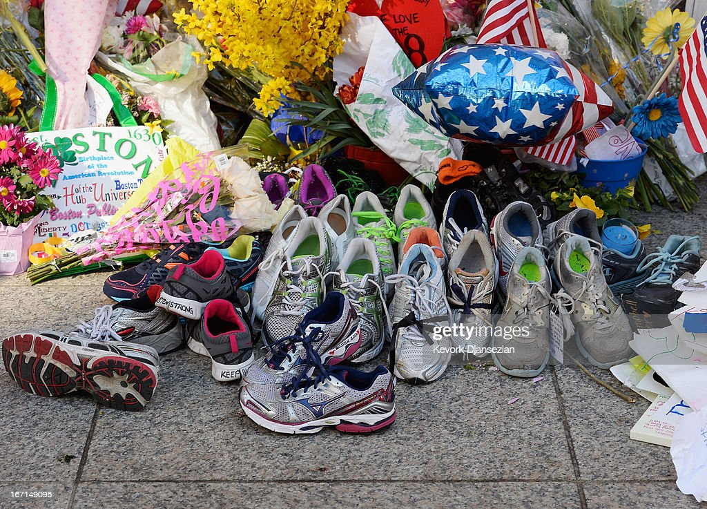 Running shoes are placed at a makeshift memorial for victims near the finish line of the Boston Marathon bombings at the intersection of Boylston Street and Berkley Street two days after the second suspect was captured on April 21, 2013 in Boston, Massachusetts. A manhunt for Dzhokhar A. Tsarnaev, 19, a suspect in the Boston Marathon bombing ended after he was apprehended on a boat parked on a residential property in Watertown, Massachusetts. His brother Tamerlan Tsarnaev, 26, the other suspect, was shot and killed after a car chase and shootout with police. The bombing, on April 15 at the finish line of the marathon, killed three people and wounded at least 170.