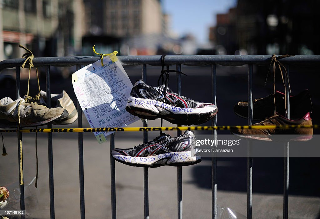 Running shoes are placed at a makeshift memorial for victims near the finish line of the Boston Marathon bombings at the intersection of Newbury Street and Darthmouth Street two days after the second suspect was captured on April 21, 2013 in Boston, Massachusetts. A manhunt for Dzhokhar A. Tsarnaev, 19, a suspect in the Boston Marathon bombing ended after he was apprehended on a boat parked on a residential property in Watertown, Massachusetts. His brother Tamerlan Tsarnaev, 26, the other suspect, was shot and killed after a car chase and shootout with police. The bombing, on April 15 at the finish line of the marathon, killed three people and wounded at least 170.
