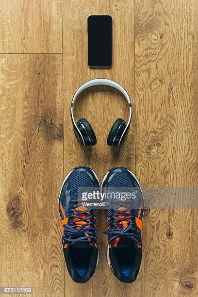 Running shoes, headphones, smartphone