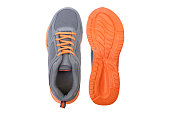 Running shoes with grey and orange colors