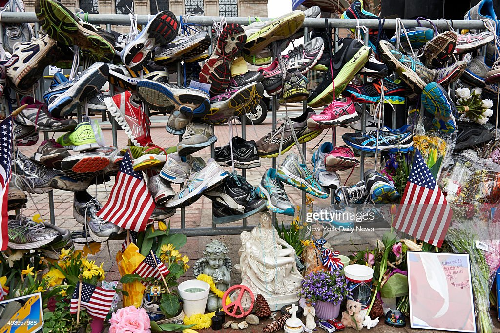 Running shoes were left at a Copley Square memorial for the victims of the Boston Marathon terror attack on Wednesday Aprril 24 2013 in Boston Mass...