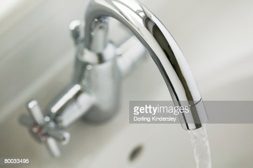 A running tap, view from above : Stock Photo