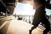 Running team, running on bridge, New York, USA