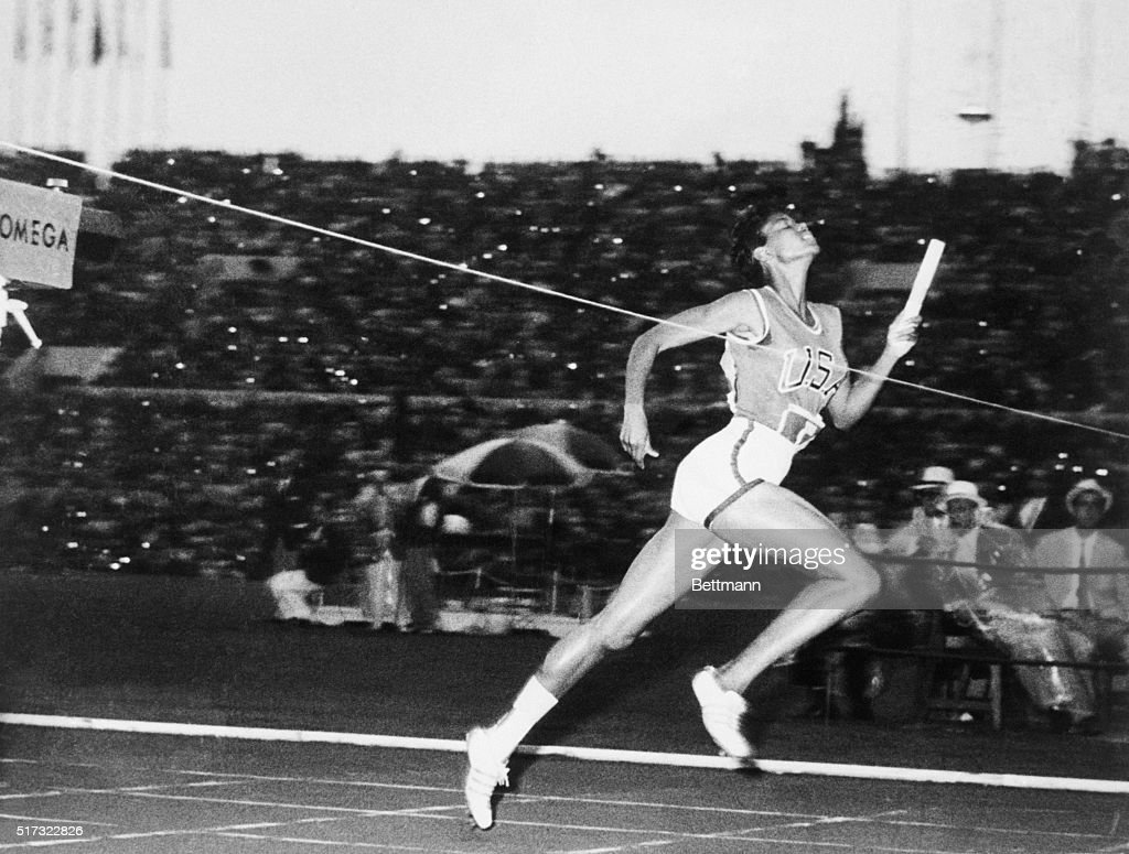 Running the anchor leg, American Wilma Rudolph crosses the finish line to win the women's 400-meter relay at the 1960 Summer Olympics in Rome. The victory gave Rudolph her third gold medal of the Olympics. September 8, 1960.