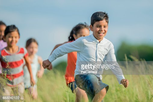 Running Through a Grassy Field : Foto stock