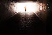 Man running through the tunnel in the sun