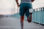 Cropped image of a man running on the bridge