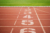 Running track number and green grass outdoor