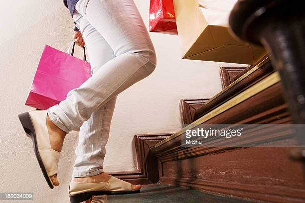 Running up the stairs after shopping