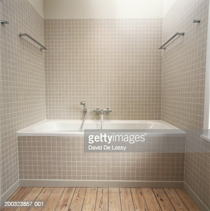 Running water flowing from faucet into bathtub