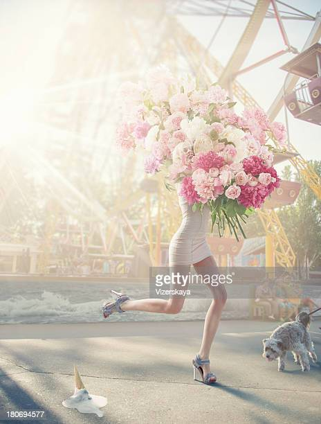 running women with giant bunch of flowers
