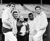 Runningback Alex Webster quarterback Charlie Conerly head coach Jim Lee Howell runningback Mel Triplettand runningback Frank Gifford of the New York...