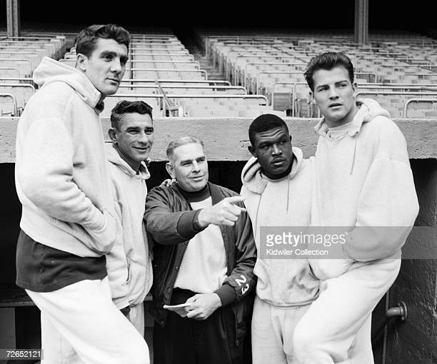 Runningback Alex Webster quarterback Charlie Conerly head coach Jim Lee Howell runningback Mel Triplettand runningback Frank Gifford of the New York...
