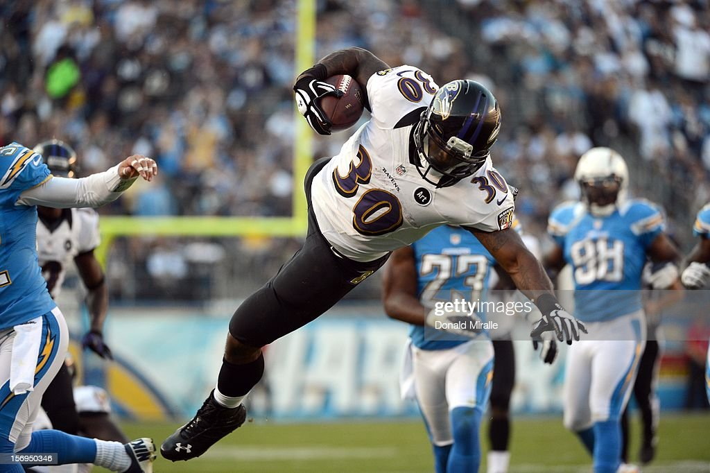 Runningback Bernard Pierce #30 of the Baltimore Ravens en route to his team's 16-13 overtime win over the San Diego Chargers on November 25, 2012 at Qualcomm Stadium in San Diego, California.