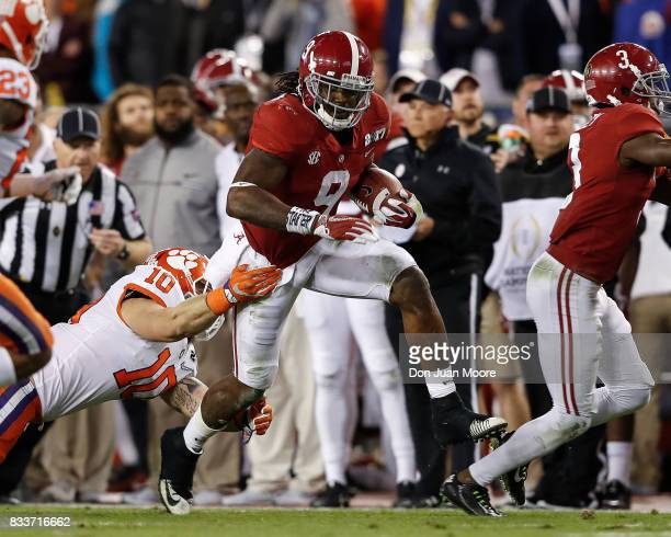 Runningback Bo Scarbrough of the Alabama Crimson Tide avoids a tackle by Linebacker Ben Boulware of the Clemson Tigers during the 2017 College...