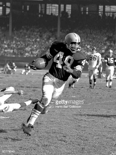 Runningback Bobby Mitchell of the Cleveland Browns runs the ball during a game on October 8 1961 against the Washington Redskins at Municipal Stadium...
