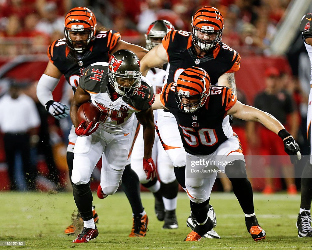Runningback Charles Sims of the Tampa Bay Buccaneers on a running play against Linebacker A.J. Hawk #50 the Cincinnati Bengals during a preseason game at Raymond James Stadium on August 24, 2015 in Tampa, Florida. The Buccaneers defeated the Bengals 25 to 11.