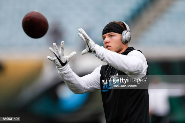Runningback Christian McCaffrey of the Carolina Panthers warms up with a pair of BOSE Headphones on before the game against the Jacksonville Jaguars...