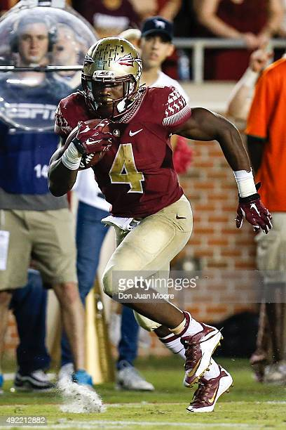 Runningback Dalvin Cook of the Florida State Seminoles during the game against the Miami Hurricanes at Doak Campbell Stadium on Bobby Bowden Field on...