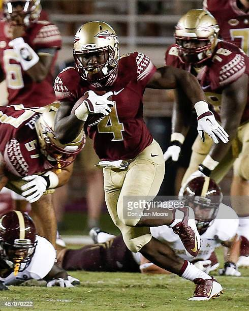 Runningback Dalvin Cook of the Florida State Seminoles on a running play during the game against the Texas State Bobcats at Doak Campbell Stadium on...