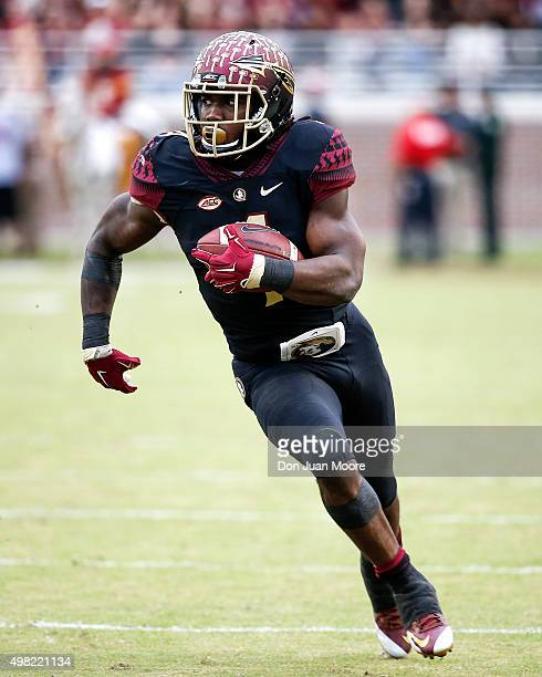 Runningback Dalvin Cook of the Florida State Seminoles on a running play during the game against the Chattanooga Mocs at Doak Campbell Stadium on...