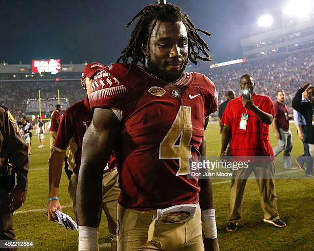 Runningback Dalvin Cook of the Florida State Seminoles walks to the locker room after the game against the Miami Hurricanes at Doak Campbell Stadium...