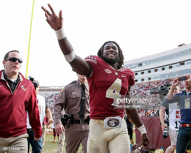 Runningback Dalvin Cook of the Florida State Seminoles wave to the crowd after the game against the North Carolina State Wolfpack at Doak Campbell...
