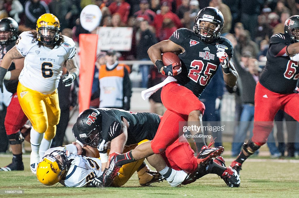 Runningback David Oku #25 of the Arkansas State Red Wolves runs the ball in for a touchdown during their game against the Kent State Golden Flashes on January 6, 2013 at Ladd-Peebles Stadium in Mobile, Alabama. Arkansas State defeated Kent State 17-13.