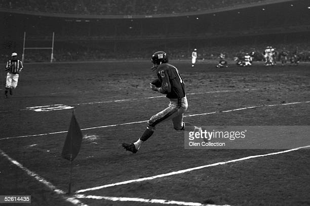 Runningback Frank Gifford of the New York Giants scores a touchdown for the Giants during a game on December 9 1962 against the Cleveland Browns at...